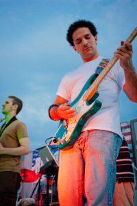 Tony Pax performing outdoors live at Senasqua Park with Surrogate Band